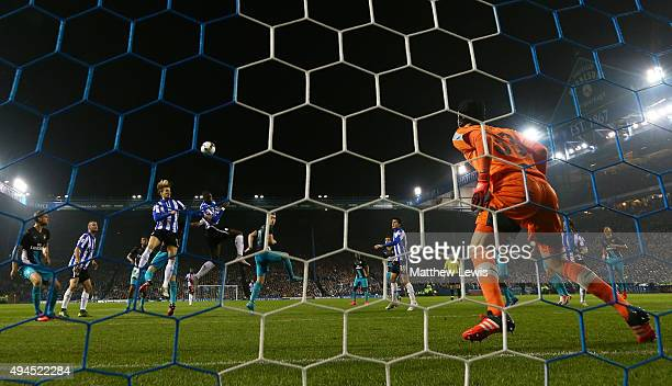 Lucas Joao of Sheffield Wednesday rises above the Arsenal defence to score his team's second goal during the Capital One Cup fourth round match...