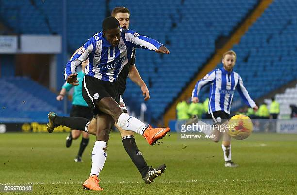 Lucas Joao of Sheffield Wednesday scores his teams fourth goal during the Sky Bet Championship match between Sheffield Wednesday and Brentford at...