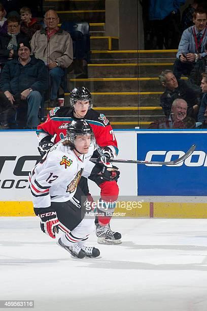 Lucas Johansen of Kelowna Rockets back checks Miles Koules of Portland Winterhawks on November 21 2014 at Prospera Place in Kelowna British Columbia...
