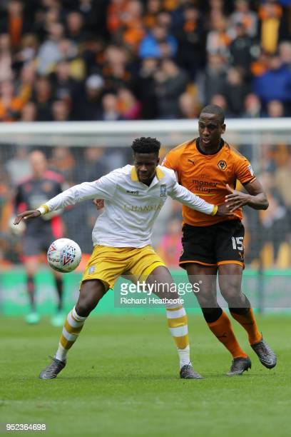 Lucas João of Sheffield Wednesday is challenged by Willy Boly of Wolverhampton Wanderers during the Sky Bet Championship match between Wolverhampton...