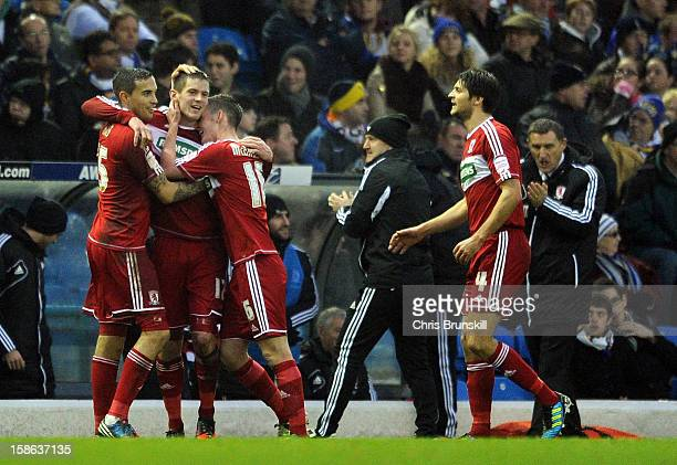 Lucas Jutkiewicz of Middlesbrough is congratulated by his team-mates after scoring the opening goal during the npower Championship match between...