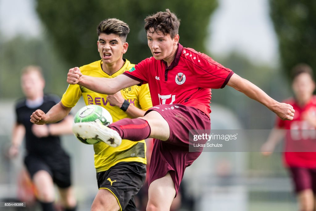 Lucas Klantzos (L) of Dortmund and Can Karaguemrueklue (R) of Koeln in action during the B Juniors Bundesliga match between Borussia Dortmund and FC Viktoria Koeln on August 19, 2017 in Dortmund, Germany.
