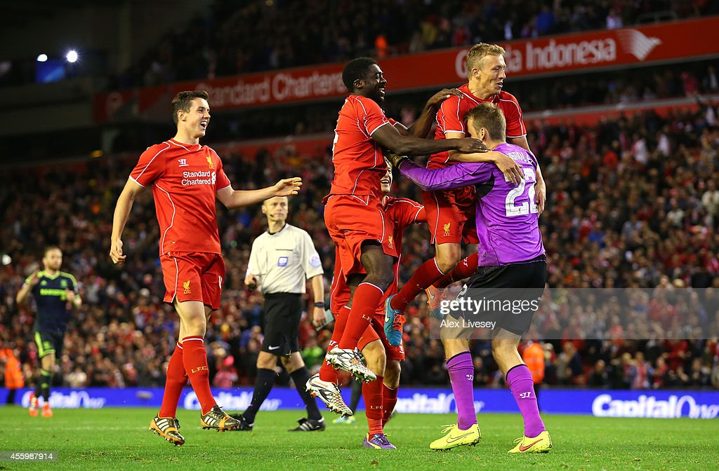 Lucas, Kolo Toure and Simon Mignolet of Liverpool celebrate after winning the match on penalties after a miss from Albert Adomah of Middlesbrough during the Capital One Cup Third Round match between Liverpool and Middlesbrough at Anfield on September 23, 2014 in Liverpool, England.