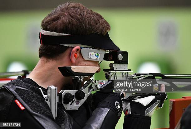 US Lucas Kozeniesky competes during the 10m Air Rifle Men's at the Olympic Shooting Centre in Rio de Janeiro on August 8 during the Rio 2016 Olympic...