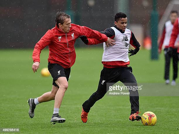 Lucas Leiva and Allan Rodrigues de Souza of Liverpool during a training session at Melwood Training Ground on November 30 2015 in Liverpool England