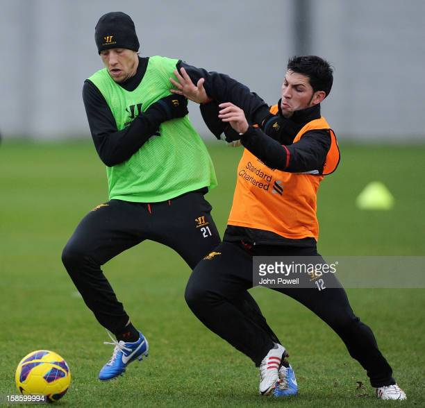 Lucas Leiva and Daniel Pacheco of Liverpool in action during a training session at Melwood Training Ground on December 20 2012 in Liverpool England