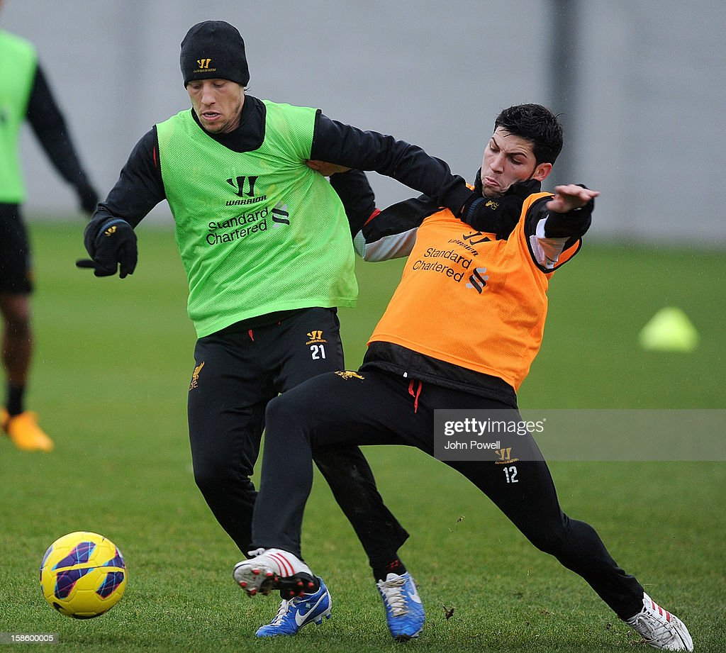 Lucas Leiva (L) and Daniel Pacheco of Liverpool in action during a training session at Melwood Training Ground on December 20, 2012 in Liverpool, England.