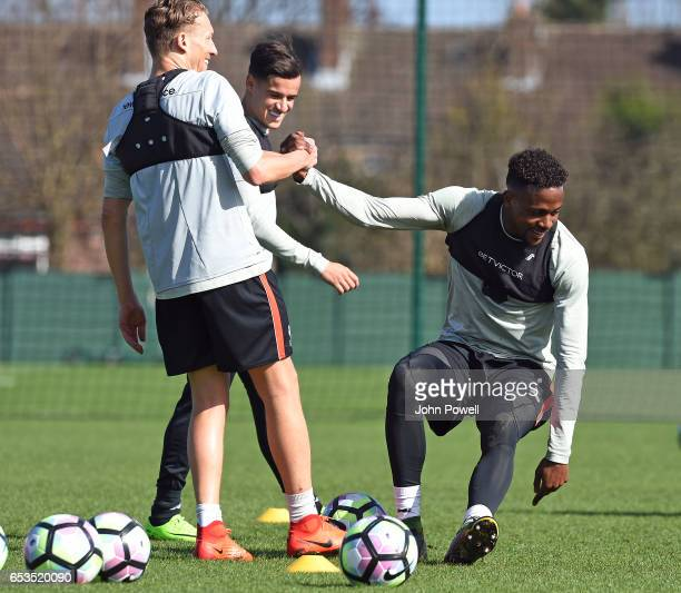 Lucas Leiva and Divock Origi of Liverpool during a training session at Melwood Training Ground on March 15 2017 in Liverpool England