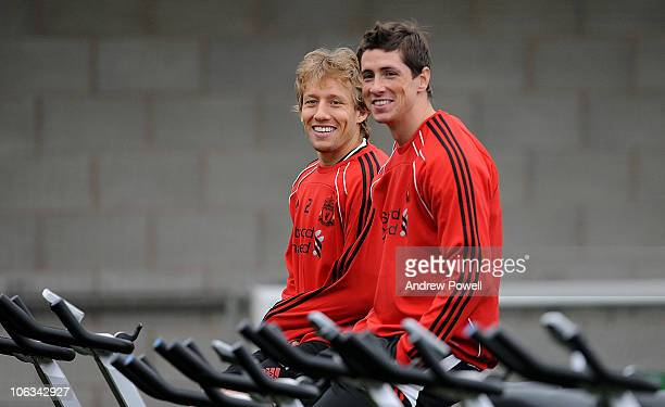 Lucas Leiva and Fernando Torres of Liverpool during a Liverpool FC training session at Melwood training ground on October 29 2010 in Liverpool England