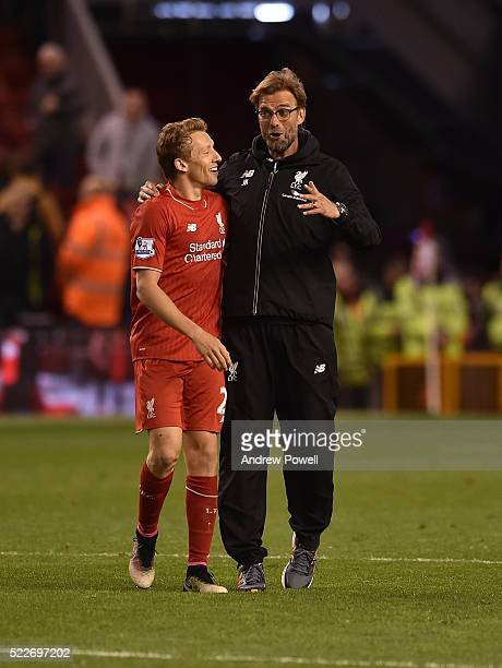 Lucas Leiva and Jurgen Klopp manager of Liverpool celebrate the win at the end of the Barclays Premier League match between Liverpool and Everton at...