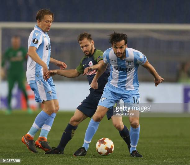 Lucas Leiva and Marco Parolo of SS Lazio competes for the ball with Andrea Ulmer of RB Salzburg during the UEFA Europa League quarter final leg one...