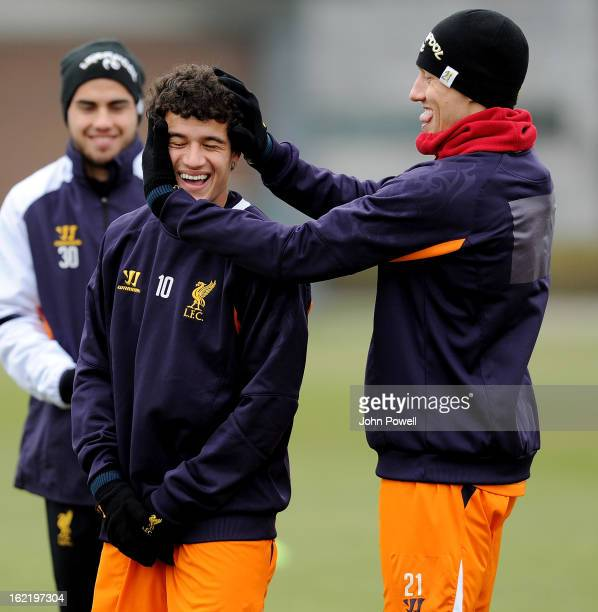 Lucas Leiva and Philippe Coutinho of Liverpool share a laugh during a training session at Melwood Training Ground on February 20 2013 in Liverpool...