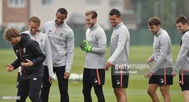 Lucas Leiva Joel Matip Loris Karius Dejan Lovren Connor Randall and James Milner of Liverpool laugh during a training session at Melwood Training...