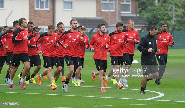 Lucas Leiva Jordan Henderson Adam Lallana and the rest of the squad during the warm up as Liverpool players return for preseason training at Melwood...