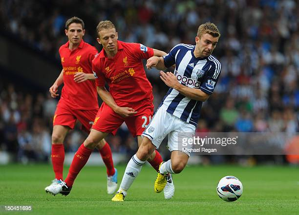 Lucas Leiva of Liverpool battles James Morrison of West Brom during the Barclays Premier League match between West Bromwich Albion and Liverpool at...