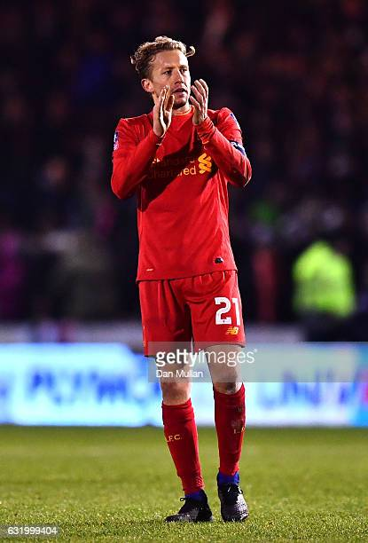 Lucas Leiva of Liverpool celebrates victory after the full time whistle in The Emirates FA Cup Third Round Replay match between Plymouth Argyle and...