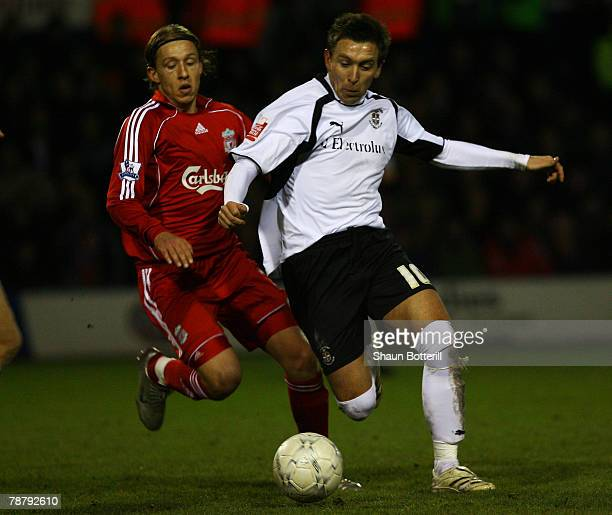 Lucas Leiva of Liverpool challenges Darren Currie of Luton during the FA Cup 3rd round sponsored by EON match between Luton Town and Liverpool at...