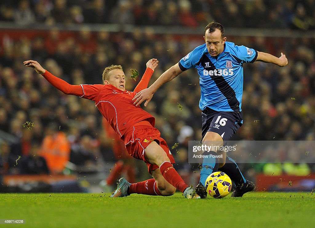 Lucas Leiva of Liverpool competes with Charlie Adam Stoke City during the Barclays Premier Leauge match between Liverpool and Stoke City at Anfield on November 29, 2014 in Liverpool, England.