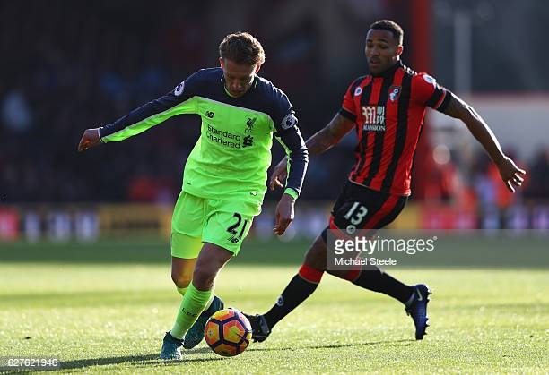 Lucas Leiva of Liverpool evades Callum Wilson of AFC Bournemouth during the Premier League match between AFC Bournemouth and Liverpool at Vitality...