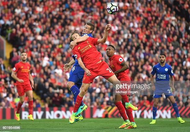 Lucas Leiva of Liverpool is tackled by Robert Huth of Leicester City during the Premier League match between Liverpool and Leicester City at Anfield...
