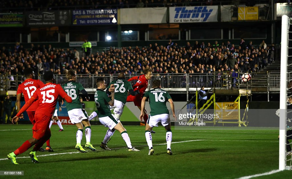 Lucas Leiva of Liverpool scores the opening goal with a header during The Emirates FA Cup Third Round Replay match between Plymouth Argyle and Liverpool at Home Park on January 18, 2017 in Plymouth, England.