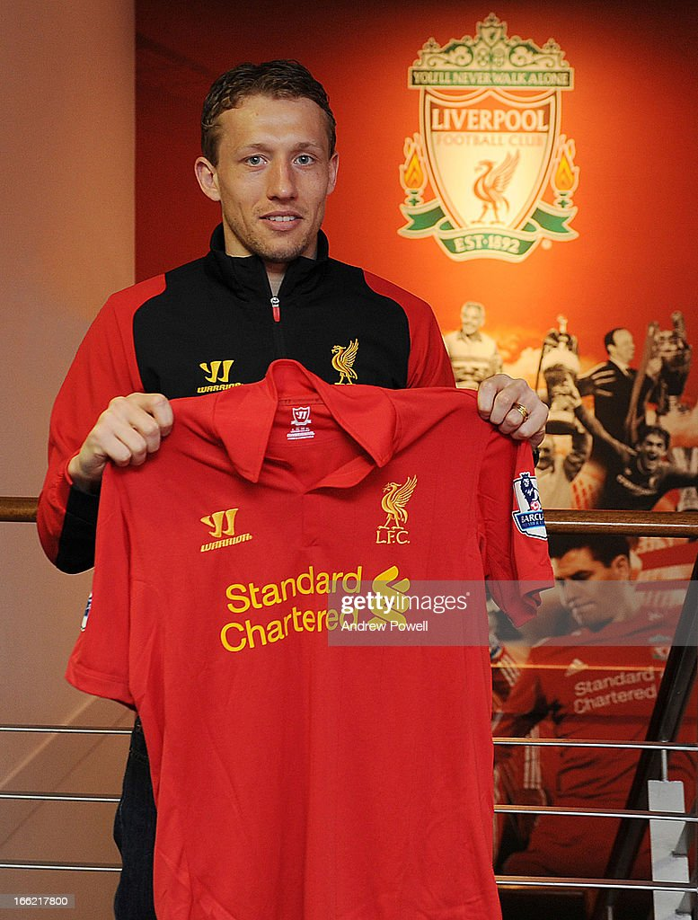 Lucas Leiva of Liverpool signs a long term extension to his contract at Melwood Training Ground on April 10, 2013 in Liverpool, England.