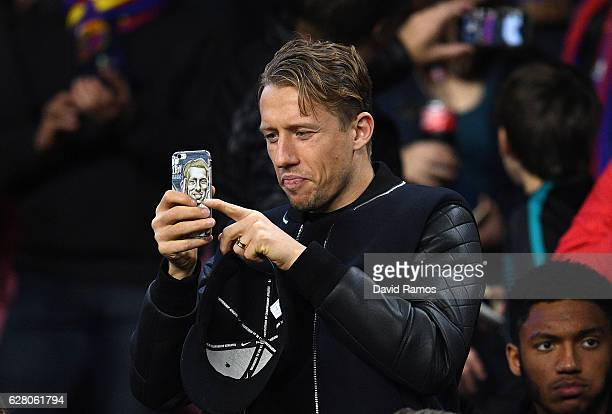Lucas Leiva of Liverpool takes a photograph in the stands during the UEFA Champions League Group C match between FC Barcelona and VfL Borussia...
