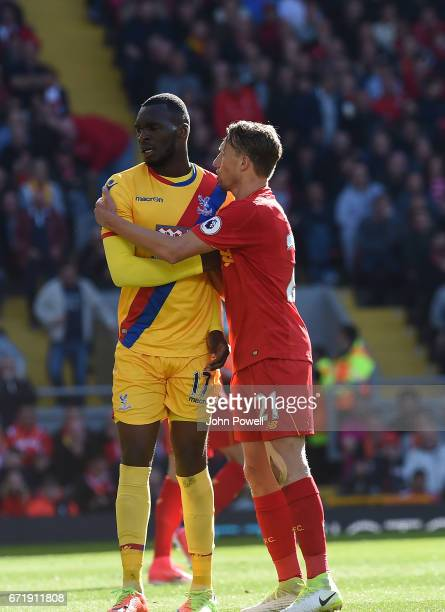 Lucas Leiva of Liverpool with Christian Benteke of Crystal Palace during the Premier League match between Liverpool and Crystal Palace at Anfield on...