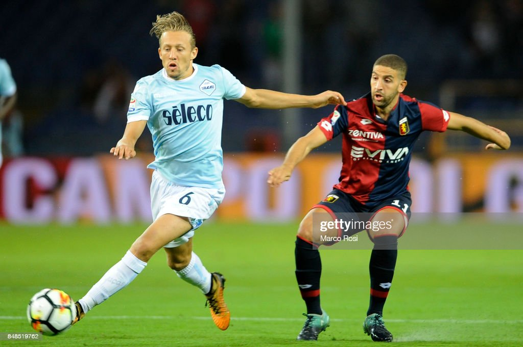 Lucas Leiva of SS Lazio compete for the ball with Adel Tarabat of Genoa CFC during the Serie A match between Genoa CFC and SS Lazio at Stadio Luigi Ferraris on September 17, 2017 in Genoa, Italy.