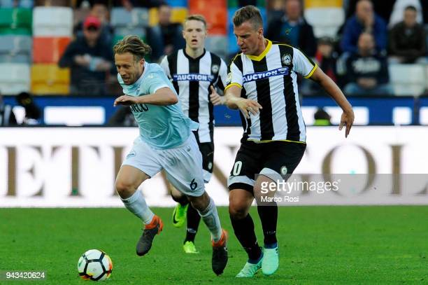 Lucas Leiva of SS Lazio compete for the ball with and Maximillian Lopez of Udinese Calcio tduring he serie A match between Udinese Calcio and SS...