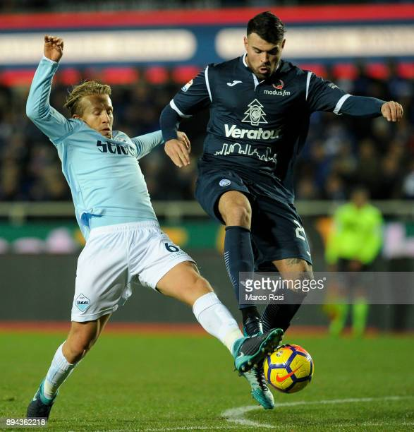 Lucas Leiva of SS Lazio compete for the ball with Andrea Petagna of Atalanta BC during the Serie A match between Atalanta BC and SS Lazio at Stadio...