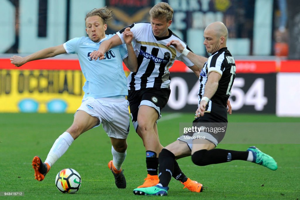 Lucas Leiva of SS Lazio compete for the ball with Antonin Barak during and Bran Nuytinck of Udinese Calcio the serie A match between Udinese Calcio and SS Lazio at Stadio Friuli on April 8, 2018 in Udine, Italy.