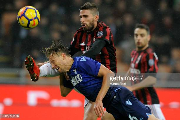 Lucas Leiva of SS Lazio compete for the ball with Fabio Borini of AC Milan during the TIM Cup match between AC Milan and SS Lazio at Stadio Giuseppe...