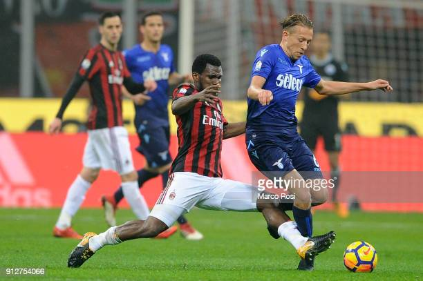 Lucas Leiva of SS Lazio compete for the ball with Franck Kessie of AC Milan during the TIM Cup match between AC Milan and SS Lazio at Stadio Giuseppe...