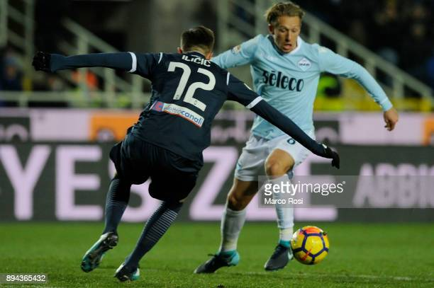 Lucas Leiva of SS Lazio compete for the ball with Josip Ilicic of Atalanta BC during the Serie A match between Atalanta BC and SS Lazio at Stadio...