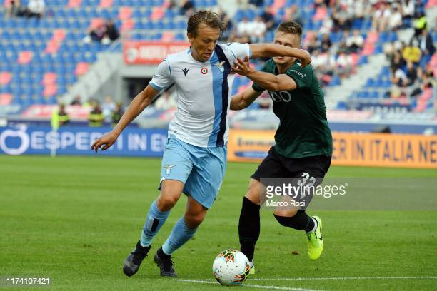 Lucas Leiva of SS Lazio compete for the ball with Mattias Svanberg of Bologna FC during the Serie A match between Bologna FC and SS Lazio at Stadio...