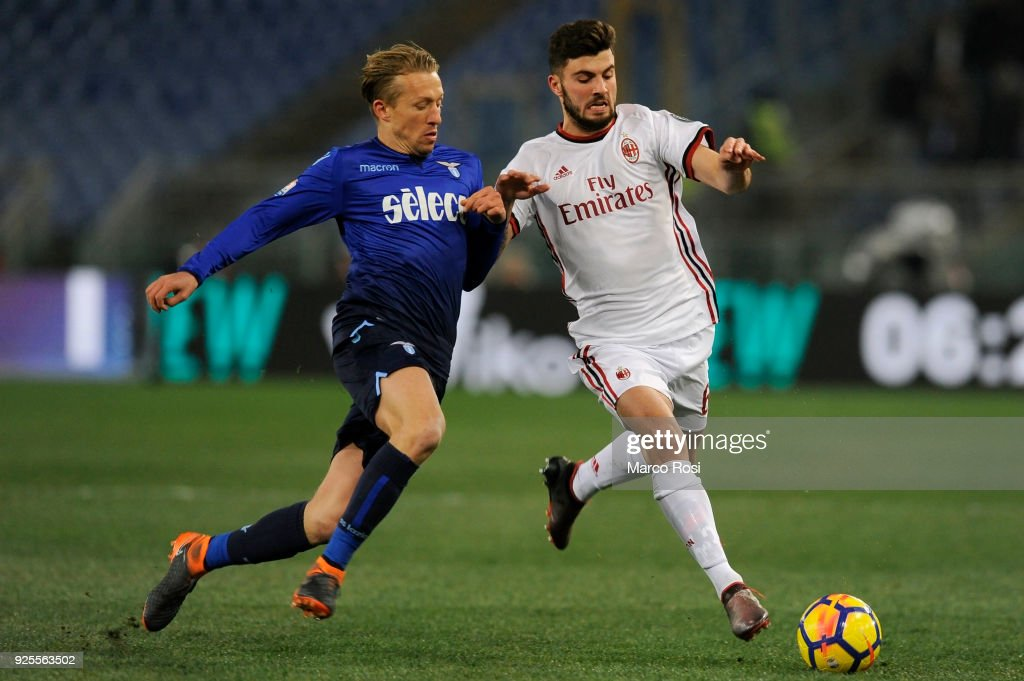 Lucas Leiva of SS Lazio compete for the ball with Patrick Cutrone of AC Milan during the TIM Cup match between SS Lazio and AC Milan at Olimpico Stadium on February 28, 2018 in Rome, Italy.