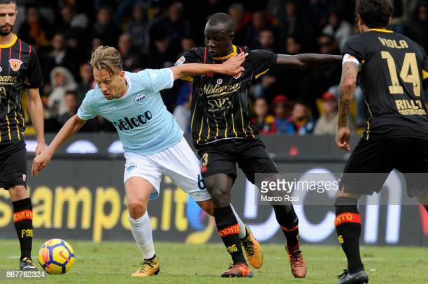 Lucas Leiva of SS Lazio compete for the ball with Yusseif Chibsah of Benevneto Calcio during the Serie A match between Benevento Calcio and SS Lazio...