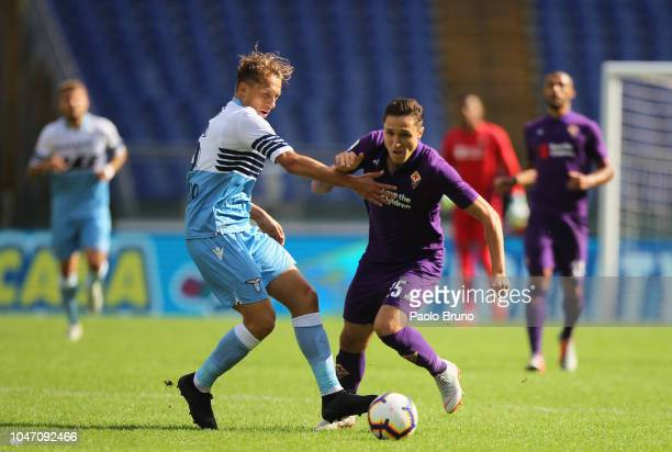 Lucas Leiva of SS Lazio competes for the ball with Enrico Chiesa of ACF Fiorentina during the Serie A match between SS Lazio and ACF Fiorentina at...
