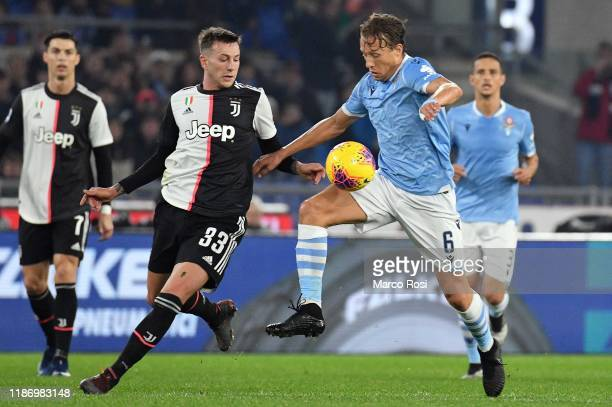 Lucas Leiva of SS Lazio competes for the ball with Federico Bernardeschi of Juventus during the Serie A match between SS Lazio and Juventus at Stadio...
