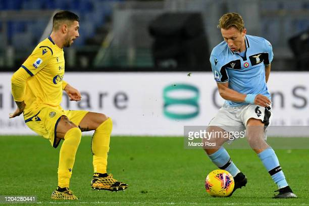 Lucas Leiva of SS Lazio competes for the ball with Mattia Zaccagni of Hellas Verona during the Serie A match between SS Lazio and Hellas Verona at...