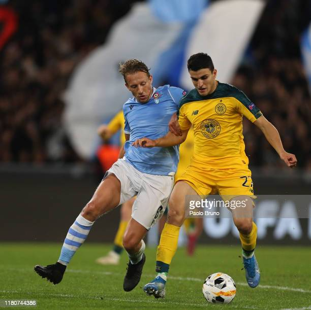 Lucas Leiva of SS Lazio competes for the ball with Mohamed Elyounoussi of Celtic FC before the UEFA Europa League group E match between SS Lazio and...