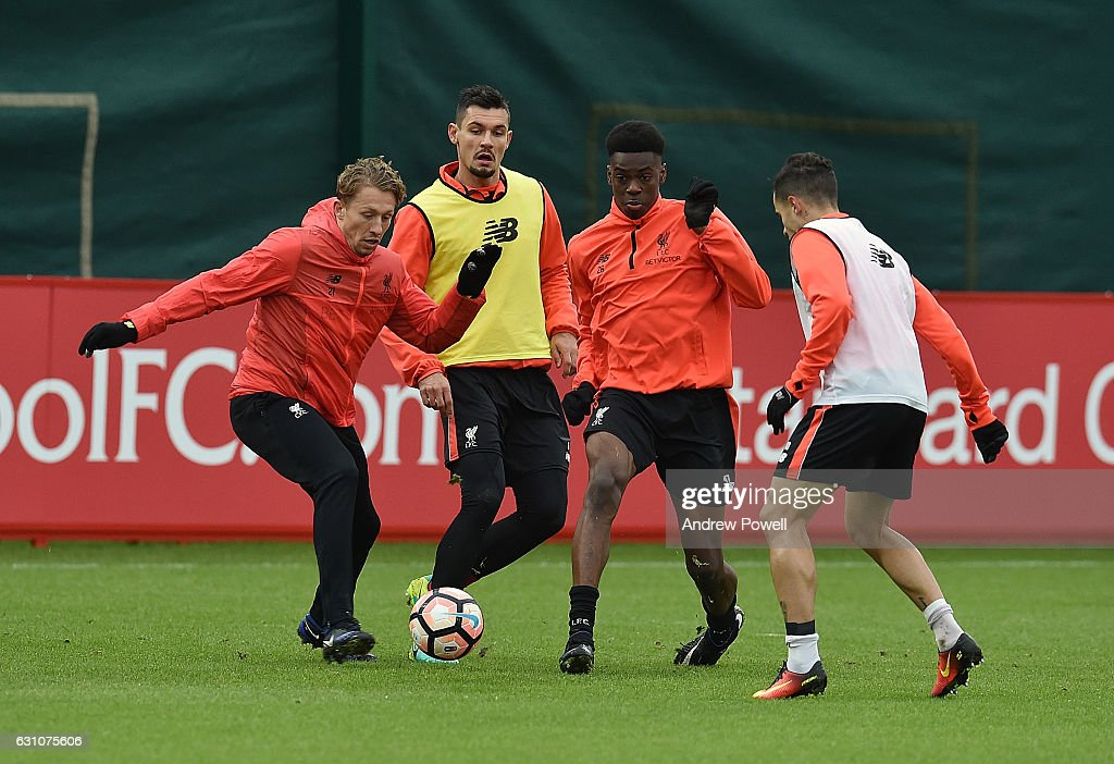 Lucas Leiva, Ovie Ejaria and Philippe Coutinho of Liverpool during a training session at Melwood Training Ground on January 6, 2017 in Liverpool, England.