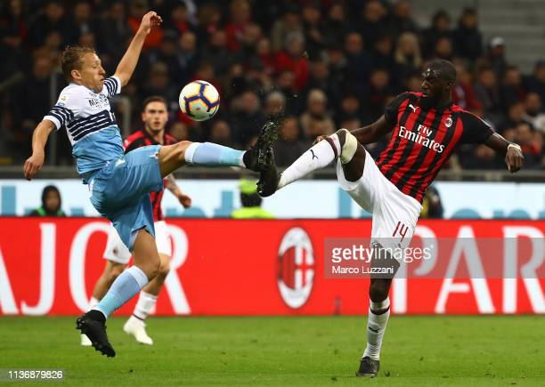 Lucas Leiva Pezzini of SS Lazio competes for the ball with Tiemoue Bakayoko of AC Milan during the Serie A match between AC Milan and SS Lazio at...