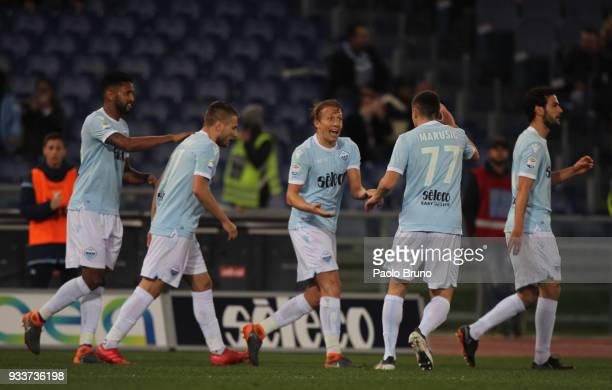 Lucas Leiva with his teammates of SS Lazio celebrates after scoring the team's first goal during the serie A match between SS Lazio and Bologna FC at...