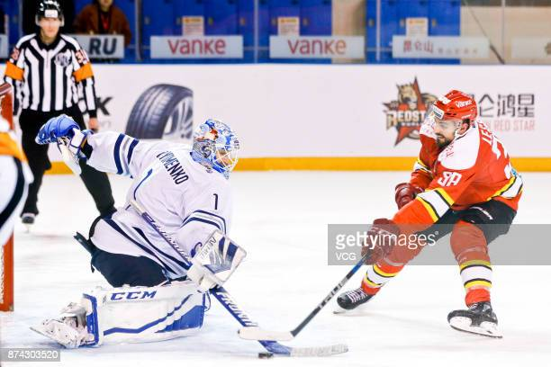 Lucas Lessio of HC Kunlun Red Star and Alexander Yeremenko of HC Dynamo Moscow vie for the puck during the 2017/18 Kontinental Hockey League Regular...