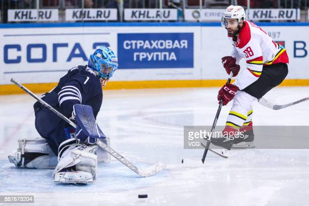 Lucas Lessio of HC Kunlun Red Star and Ivan Nalimov of Admiral Vladivostok vie for the puck during the 2017/18 Kontinental Hockey League KHL Regular...