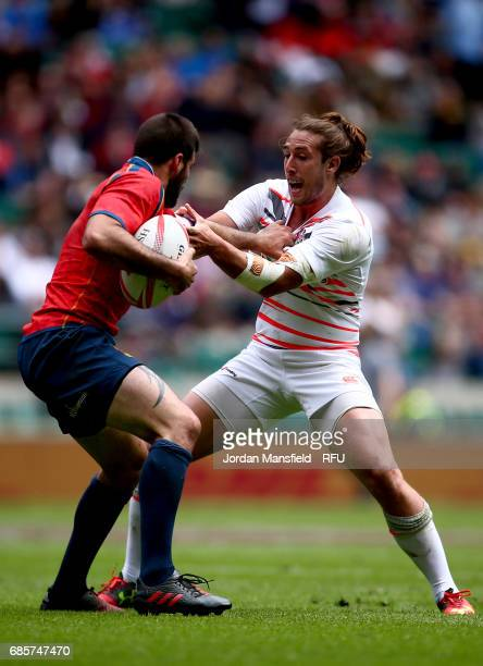 Lucas Levy of Spain is tackled by Dan Bibby of England during the match between England and Spain during day one of the HSBC London Sevens at...