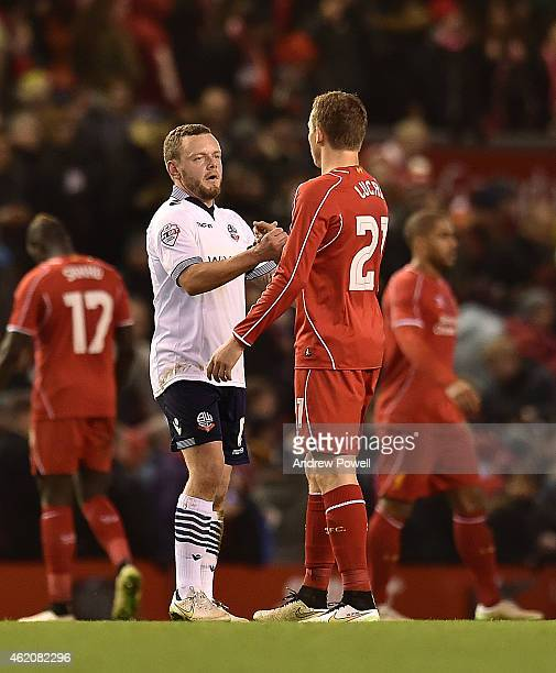 Lucas Lieva of Liverpool shakes hands with Jay Spearing of Bolton at the end of the FA Cup Fourth Round match between Liverpool and Bolton Wanderers...