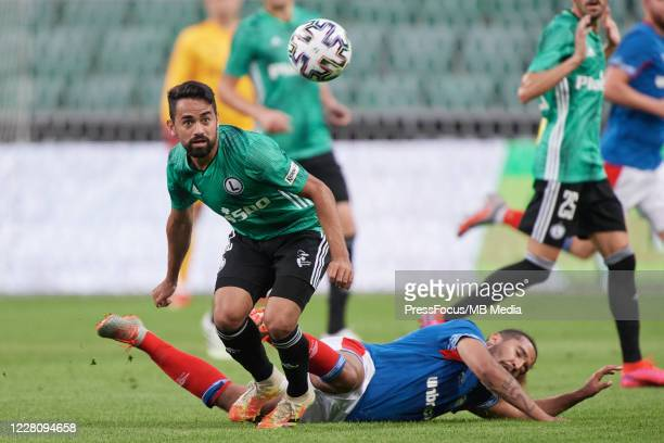 Lucas Lima Linhares Luquinhas of Legia and Bastien Hery of Linfield compete for the ball during UEFA Champions League First Qualifying Round match...